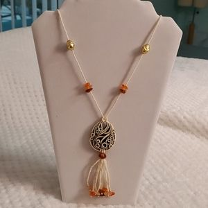 Beautiful beaded necklace.  Amber and cream.